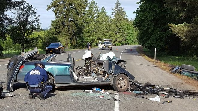 Oregon State Police investigate a fatal crash on Highway 22 just west of Lyons on Monday, May 9, 2016.