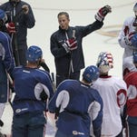Rochester Americans' Drew Bagnall, center, is congratulated by teammates after he was named team captain.