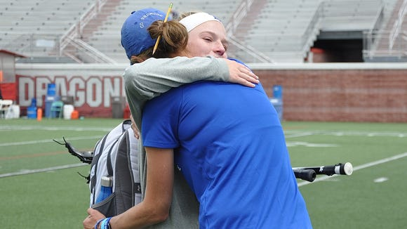 Bronxville coach Sharon Robinson hugs senior Grace Randall after the Broncos fell in the Class D State Championship.