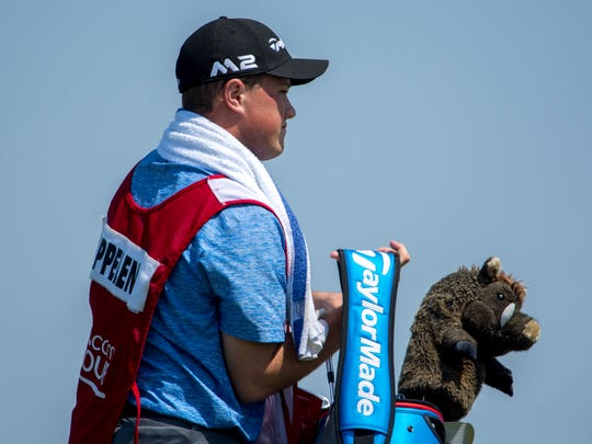 Walter Beck, 17, a junior at Castle High School, is Web.com Tour golfer Sebastian Cappelen's caddie for the United Leasing & Finance Championship at Victoria National Golf Club Friday morning. Cappelen played for the University of Arkansas Razorbacks and sports a golf head cover with the school's mascot.