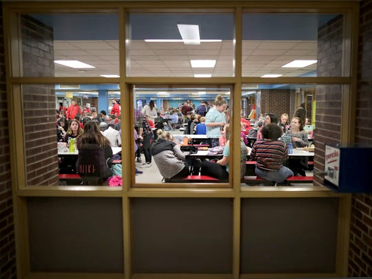 Students take a lunch break in the cafeteria at Shattuck Middle School in Neenah. Voters will determine the fate of the Neenah Joint School District's plan to build a replacement for the school in April.