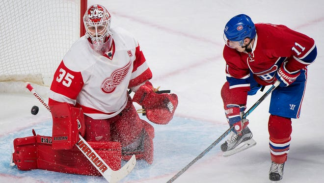 Red Wings goaltender Jimmy Howard is scored on by the Canadiens' Shea Weber, not shown, as Brendan Gallagher looks for the rebound during the first period Saturday in Montreal.