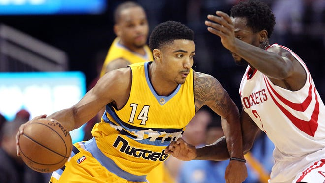 Denver Nuggets guard Gary Harris (14) dribbles against Houston Rockets guard Patrick Beverley (2) in the first quarter at Toyota Center.