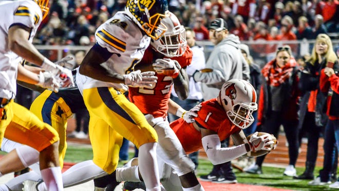 Colerain running back Syncere Jones (1) dives into the endzone for a Cardinal touchdown against Moeller in a OHSAA Region 4 playoff game, Friday November 3, 2017