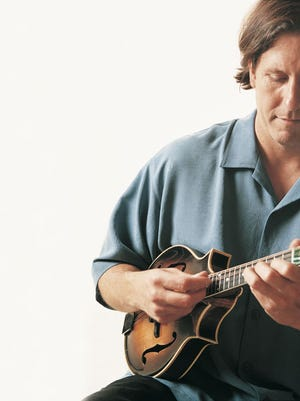 Tom Corbett leads a trio that is bringing traditional American music to the Santa Paula Theater.
