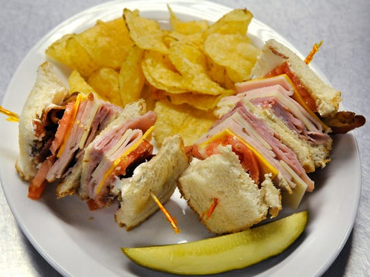 At left: A clubhouse sandwich is plated up and ready to be served.