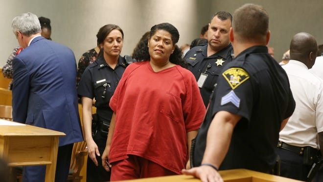 Rochester City Court Judge Leticia Astacio, center, is taken back to jail after she was found guilty of breaking the conditions of her DWI sentence during her hearing at the Hall of Justice in Rochester Thursday, June 8, 2017.