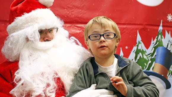 Callen Hoefle, 6, of Ankeny visits with Santa about