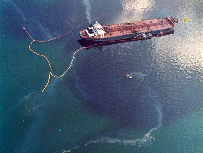 Crude oil leaks from the grounded tanker Exxon Valdez on April 9, 1989, in Prince William Sound near Naked Island, Alaska. The tanker, carrying 53 million gallons of crude oil, struck Bligh Reef at 12:04 a.m. on March 24, 1989, and leaked 10.8 million gallons of thick, toxic crude oil into the water.