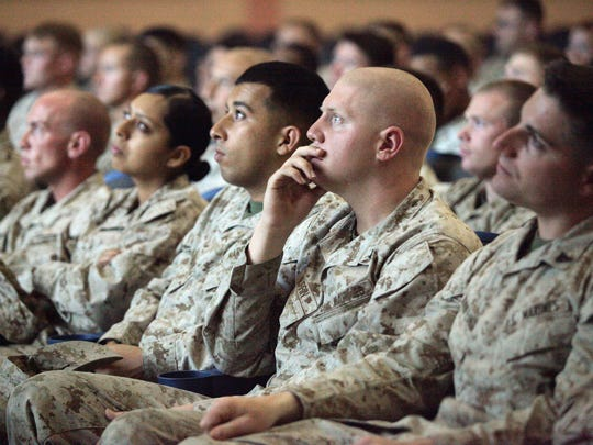 Marines from the base Headquarters Battalion watch a safe driving presentation during a briefing at the Marine Corps Air Ground Combat Center in Twentynine Palms on May 16, 2013. The base holds frequent safety briefings in an effort to protect Marines from off-duty car crashes.