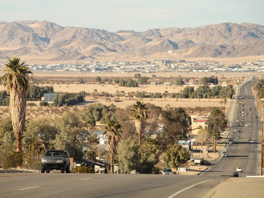 Afternoon traffic travels along Adobe Road on Feb. 7 toward the Marine Corps Air Ground Combat Center in Twentynine Palms, which is visible on the distance.