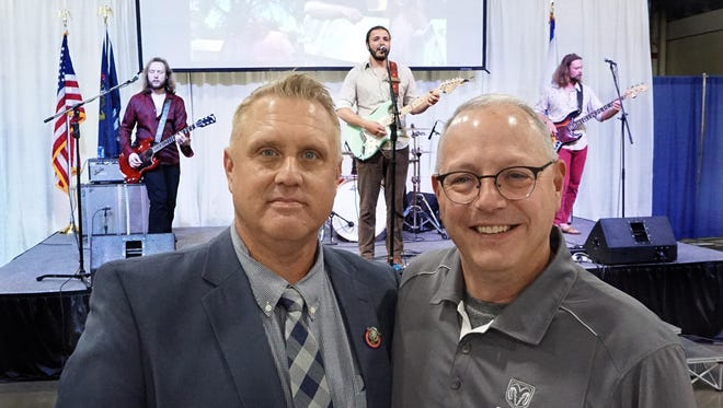 Michigan State Fair Executive Director Steve Masters with Ram Brand Marketing Manager Mark Heber and the Gasoline Gypsies at state fair press conference.