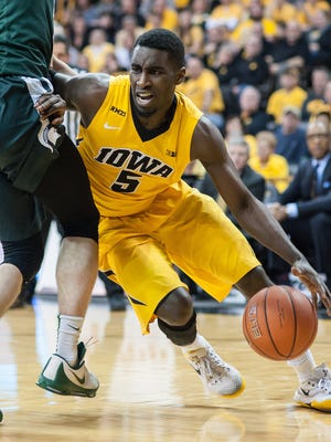 Iowa guard Anthony Clemmons dribbles Tuesday against Michigan State.