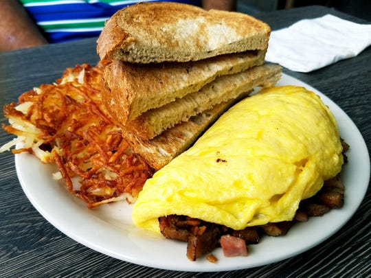 Metro Diner's meat-lovers omelet is shown with crispy