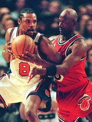 New York Knicks guard Latrell Sprewell(L) tries to keep the ball away from Miami Heat guard Terry Porter in the first quarter May 5, 1999 at Madison Square Garden in New York, NY.