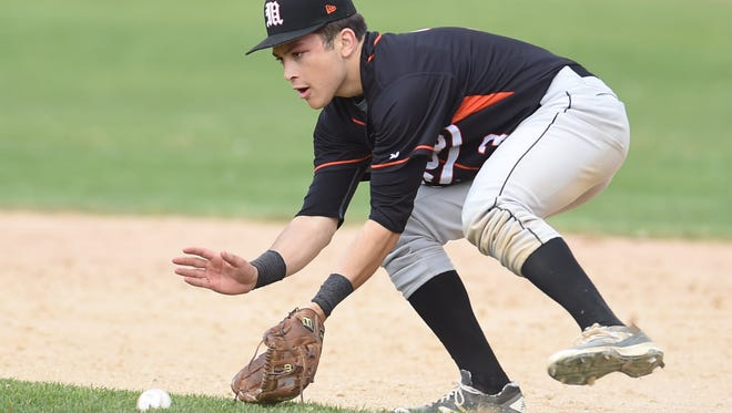 Marlboro's John Mooradian scoops a ground ball in a game against New Paltz on May 10.