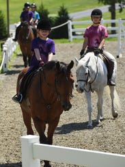 Maria Carozza, 7, of Hopewell Junction leads the pack