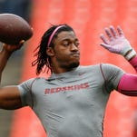 FILE - In this Oct. 4, 2015, file photo, Washington Redskins quarterback Robert Griffin III (10) warms up before an NFL football game against the Philadelphia Eagles in Landover, Md. The Browns have signed free agent quarterback Robert Griffin III, who hasn't been the same since his dazzling rookie season in Washington.  Griffin, who didn't play a snap in 2015, was recently released by the Redskins. (AP Photo/Patrick Semansky, File)