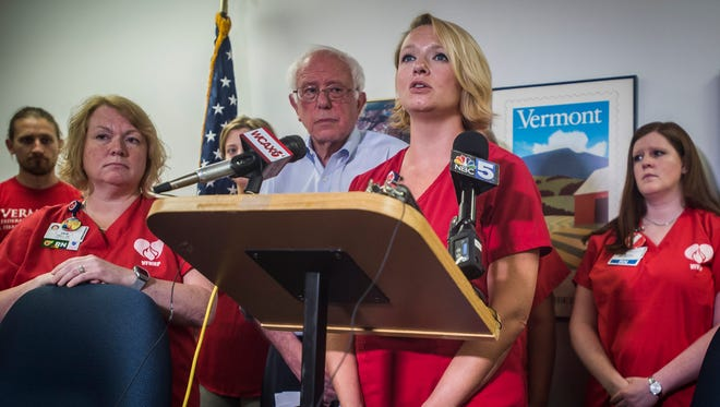 Julie MacMillan, lead negotiator for VFNHP, speaks at the Burlington office of Sen. Bernie Sanders, I-VT, on Friday, July 7, 2018, during a news conference held by Sanders in support of nurses at UVM Medical Center who are in negotiations with the hospital. The nurses union voted to strike next week if they cannot come to an agreement over pay, staffing and other issues.