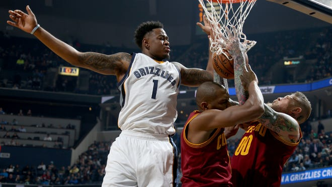 The Grizzlies' Jarell Martin gets in a tangle with the Cavaliers' James Jones and Chris Andersen.