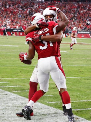 Arizona Cardinals Larry Fitzgerald hugs David Johnson (31) after taking a pass from Carson Palmer for a 55-yard touchdwon against New Orleans Saints during the second half on Sep. 13, 2015 in Glendale, AZ.