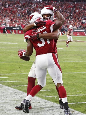 Arizona Cardinals' Larry Fitzgerald and David Johnson  are among the Top 50 players in the NFL in merchandise sold.