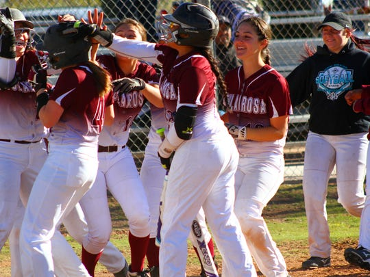 Tularosa freshman Shacie Marr (4) is congratulated by her teammates after hitting a two-run homer during the bottom of the second Tuesday evening.