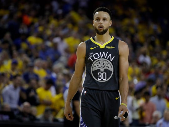 Sports fans are most familiar seeing Stephen Curry on the basketball court, as the Golden State Warriors star is seen here during this month's NBA Finals.