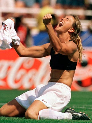 In this iconic photo, Brandi Chastain celebrates scoring the winning goal of the 1999 Women's World Cup by taking off her jersey.