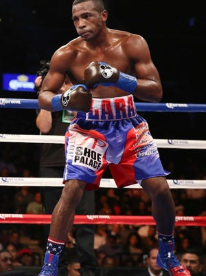In this Oct. 14, 2017, file photo, Erislandy Lara is shown in action against Terrell Gausha during the super WBA/IBO super welterweight world championship match, Oct. 14, 2017, in New York. Lara and fellow boxing star Luis Ortiz left behind their lives in Cuba for the ones they wanted for themselves and their families in the United States.