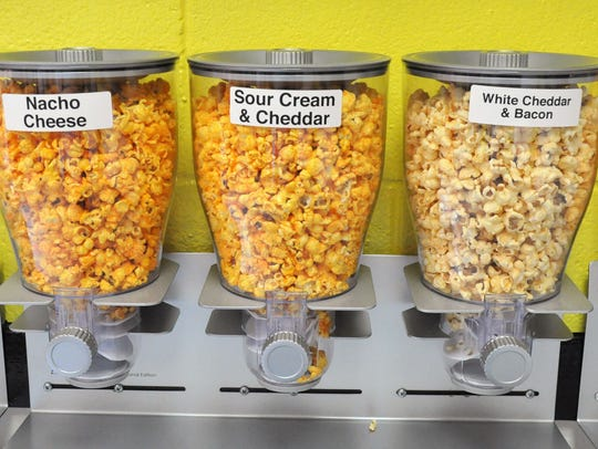 Cheese varieties of flavored popcorn are in sample dispensers at Abilene Specialty Popcorn Store on Wednesday.