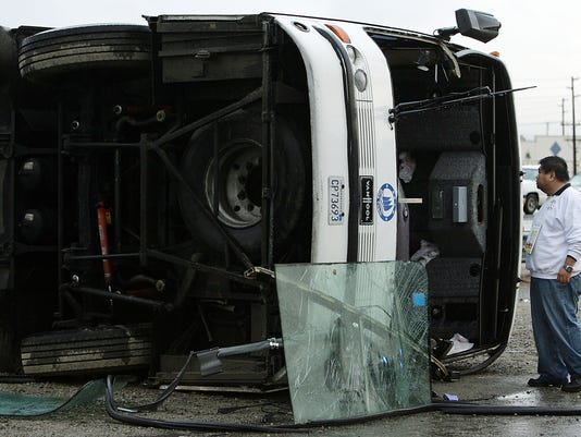 One dead, dozens hurt in three Calif  bus crashes