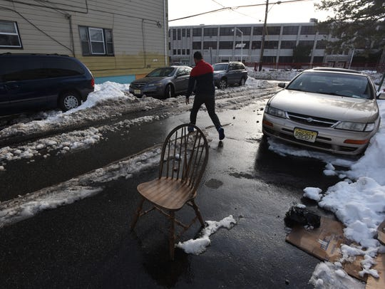 2016:Garbage pails, traffic cones and chairs take up