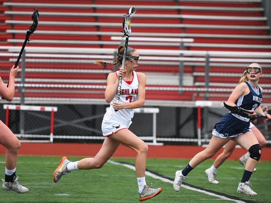 Julia Bradbury (no. 7) of Northern Highlands runs with a ball against  Wayne Valley in the first half during the North 1, Group 3 girls lacrosse state semifinal game at Northern Highlands High School in Allendale on May 22nd, 2017. 