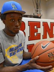 Kory Holden signed his letter of intent with University of Delaware to play basketball in the fall of 2013 at James M. Bennett high school.