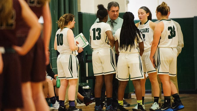 Winooski head coach Tom Prim talks to the team during a time out in the girls basketball game between BFA-Fairfax and Winooski at Winooski High School on Wednesday night December 20, 2017 in Winooski.