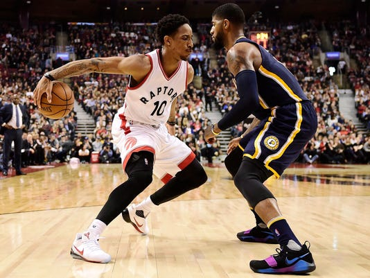 Toronto Raptors guard DeMar DeRozan (10) tries to get past Indiana Pacers forward Paul George (13) during the first half of an NBA basketball game in Toronto on Sunday, March 19, 2017. (Frank Gunn/The Canadian Press via AP)