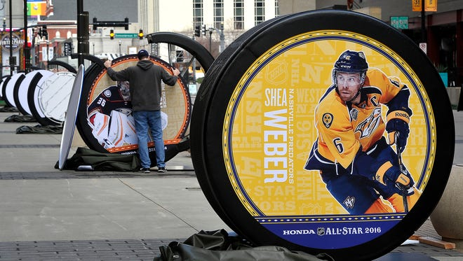 Shea Weber is featured on one of several giant pucks being installed along 5th Ave by David Dion. The NHL is installing giant NHL pucks featuring the images of NHL All-Star players throughout downtown Nashville  Wednesday Jan. 27, 2016, in Nashville, Tenn.
