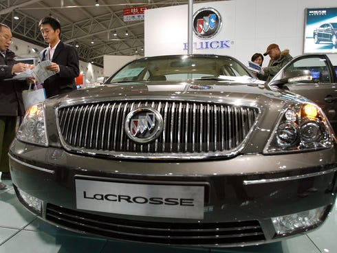 Visitors checking out a new Buick LaCrosse sedan, during the Beijing
