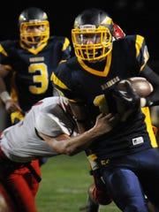 Annville Cleona's Gavin Stout attempts to tackle Elco's