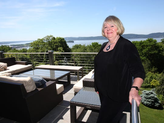 Architect Carol Cioppa stands June 16, 2014 on the deck of a home in Croton that has spectacular views of the Hudson River. She specializes in transforming old houses into modern marvels.