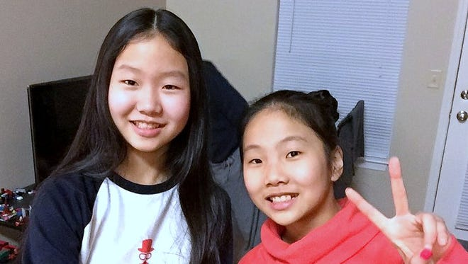 Carolyn Lee, left, and her sister Subin are among the best and brightest students.