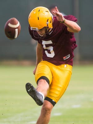 Kicker Zane Gonzalez boots a field goal during the Arizona State University football practice in Tempe, Friday, Aug. 22, 2014.