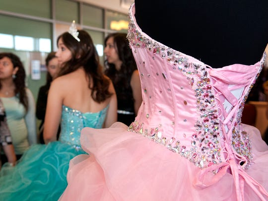 Farcia Garcia, wearing a Quinceanera dress from Renee's Bridal, speaks with some prospective clients at this year's Las Cruces Bridal Showcase.
