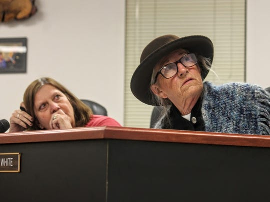 Commissioners Susan Flores and Janet White glance at their television screen observing the Peñasco wetland area.