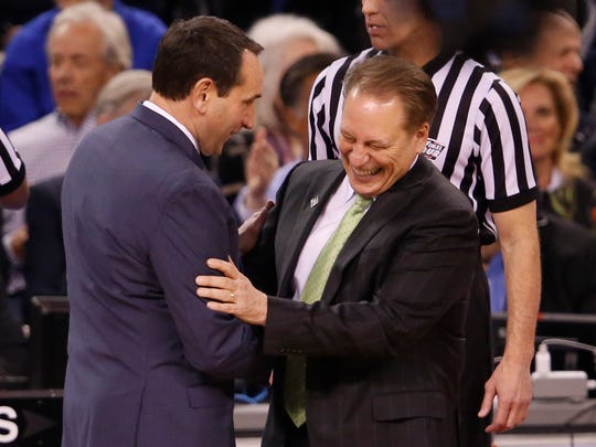 Apr 4, 2015; Indianapolis, IN, USA; Duke Blue Devils head coach Mike Krzyzewski greets Michigan State Spartans head coach Tom Izzo before the 2015 NCAA Men's Division I Championship semi-final game at Lucas Oil Stadium. Mandatory Credit: Brian Spurlock-USA TODAY Sports