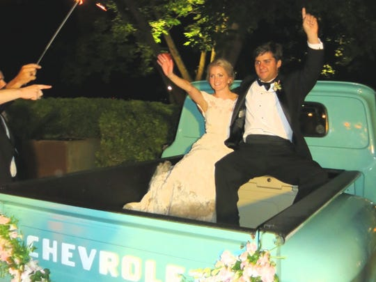 They're off! Mr. and Mrs. Brett Hernandez leave from Frierson Plantation after their wedding reception in in a 1956 truck.