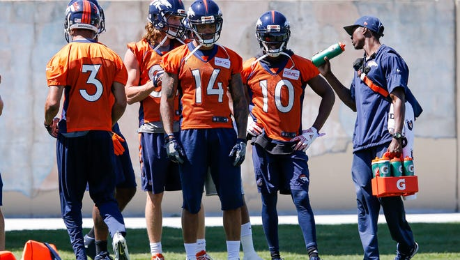 Denver Broncos wide receiver Cody Latimer (14) and wide receiver Emmanuel Sanders (10) look on during minicamp at UCHealth Training Center on June 13.