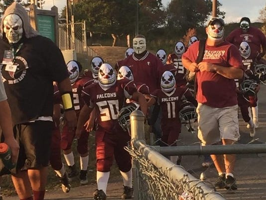 Fulton Falcons in clown masks