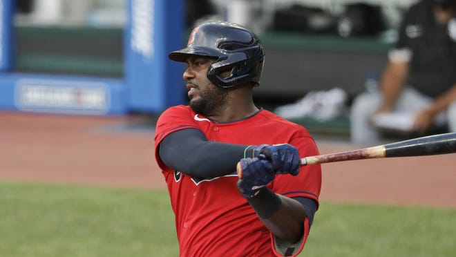 Cleveland Indians' Franmil Reyes bats against the Chicago White Sox in the fifth inning in a baseball game, Wednesday, July 29, 2020, in Cleveland.